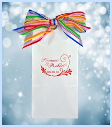 "This primary stripe organza ribbon is the finishing touch to this stylish wedding favor. The glossy white bag is printed in red satin foil for a dressy feel. Almost 8"" tall, this self-sealing bag can accommodate a large muffin, bagel & cream cheese, home-made cookies or any local goody. Acid-free, this #favorbag is FDA approved for direct food contact.  Visit www.favorsyoukeep... or call 512.323.0600. Family owned and operated since 1987!"
