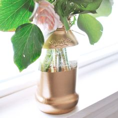 An easy DIY tutorial for making a gold vase from a pasta sauce jar!