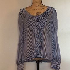 Sheer pin strip, ruffle front blouse Beautiful never been worn sheer blouse. Pinstripes make the blouse dressier and ruffle front accent is lovely. Buttons in back. Second and third pictures show detail of back of shirt. Cotton + Candy Tops Blouses