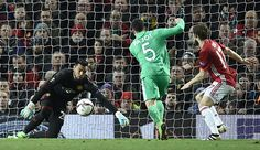 Manchester United's Argentinian goalkeeper Sergio Romero dives to save a shot from SaintEtienne's French midfielder Vincent Pajot during the UEFA...