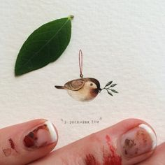 Day 337: Christmastime!  23 x 19mm. #365postcardsforants #wdc624 #miniature #watercolour #painting #bird #christmas #ornament #capetown  (at V&A Waterfront)