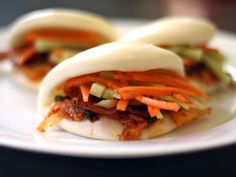 Bacon and kimchi steamed buns with carrot and cucumber slaw // Serious Eats Slaw Recipes, Carrot Recipes, Bacon Recipes, Cucumber Slaw Recipe, Cucumber Recipes, Pork Buns, Steamed Buns, Serious Eats, Kimchi