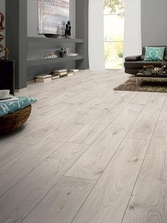 BuildDirect – Laminate - 12mm Mammut Collection – Everest Oak White - Living Room View Más