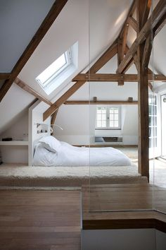 The skylight adds so much extra light in this simple white loft conversion.