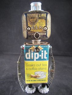 #906 Dippy Penguin Bot – A one of a kind found object robot sculpted by Cheri Kudja.    Presenting Dippy. I loved Happy Feet so this is a tribute to that