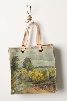 made out of an old oil painting affixed to a canvas bag.