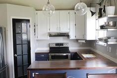 DIY Walnut Countertops--Sanded, Sealed and Finished! love this kitchen, even if its not quite finished yet. Also, a great place for inexpensive butcher block!!!