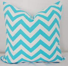 Also known as chevron, this Turquoise Zig Zag pillow will refresh your modern, casual space with a zing of bright, fresh color. Pair it with the Turquoise Geometric Pillow  for a complete look.    Size: 18x18   Zipper closure.