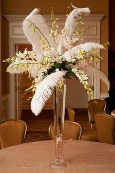 I Want To Design This For Someone How Fun Centerpiece Featuring Dendrobium Orchids And Ostrich Feather Centerpiecesflower