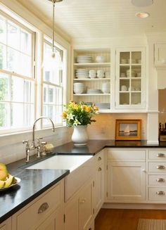white kitchen, black counters, inset cabinets
