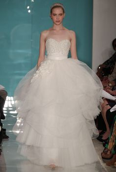 """Brides: Reem Acra - Spring 2013. """"Daisee"""" strapless ball gown wedding dress with a beaded sweetheart bodice and layered tulle skirt, Reem Acra"""