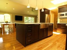 A gorgeous kitchen with rich brown wood and stunning lanterns to give it warmth with a whole lot of contemporary. www.kmrenovate.com