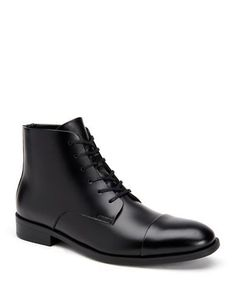 <ul><li>Polished solid boots render a handsome appeal</li><li>Leather upper</li><li>Cap toe</li><li>Lace-up/zip closure</li><li>Leather/synthetic/textile lining</li><li>Rubber sole</li><li>Imported</li></ul>