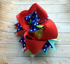 Girls hair bow, Red, Blue, Aqua, Green Boutique Hair Bow - New item for Spring! https://www.etsy.com/listing/178293858/blue-red-polka-dot-stacked-boutique-hair?ref=shop_home_active_18