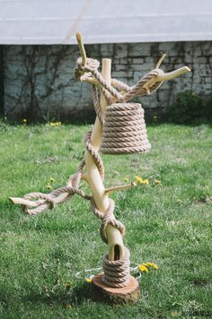 Lamp from wood and rope