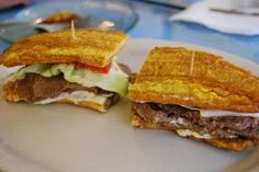 Jibarrito Sandwich, made with steak (or meat of your choice), fried smashed plantain coated with garlic, olive oil & salt. Steak, lettuce, tomato, mayo & cheese of your choice. So ridiculously good! mm mmm!