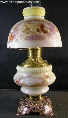 This half shade parlor lamp has an understated appeal. The combination of finely detailed transfers and subtle hand painting combine to create a very attractive antique oil lamp.