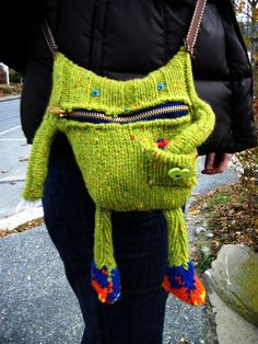 I made this for Dorian whule up in P-Town, MASS. He's made from upcycled sweater with a metal zipper mouth. His strap is ribbon and his eyes are glue on goggley eyes. He has a pocket with a stuffed...