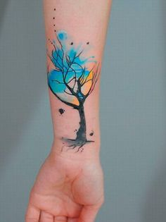 Watercolor tree tattoo. Don't like the placement, but love the tat.