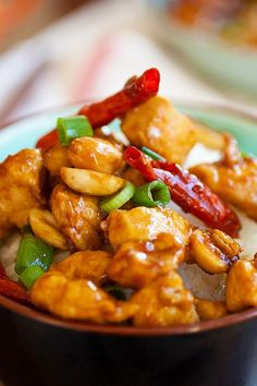 Homemade Kung Pao Chicken served in a rice bowl with steamed rice.