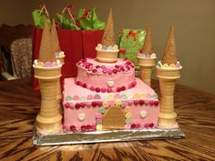 (for the future) Easy to assemble pink princess castle cake (just the picture. Two square cakes, two smaller circles, graham cracker door, sugar cones and cake cones for the towers, candy for decoration.) my 2 year old loved it! Castle Birthday Cakes, Unique Birthday Cakes, Diy Birthday Cake, Novelty Birthday Cakes, Girl Birthday, Birthday Ideas, Disney Princess Party, Princess Castle, Pink Princess