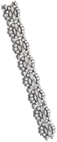 Diamond bracelet, Harry Winston  The flexible band set with marquise-shaped, brilliant- and circular-cut diamonds, unsigned, maker's m...