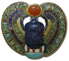 Stunning Egyptian brooch with inlay of precious stones in cloissons of gold. A winged scarab made of lapis lazulli, malachite, turqoise and a carnelian sun.