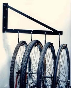 TidyGarage Wall Mounted Bike Rack by TidyGarage. $36.95. Wall Mounted. Heavy Duty Steel. Hardware Shown in the Picture is Included. AvailableOnly in White Color. Good to hang 4 Bicycles. This handy hanging bicycle storage rack will store up to four bicycles. Our bicycle hangers conveniently hang bikes vertically, on sturdy hooks that have a protective vinyl coating, to protect your front rim from scratches. All of the hardware shown in the picture is included...