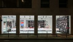 """Kartell showroom windows with the """"Kartell at the table"""" set up"""