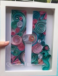 """A #quilled #letter """"h"""" by #QuillingFun with a seahorse in teals and pinks.  www.facebook.com/quillingfun"""