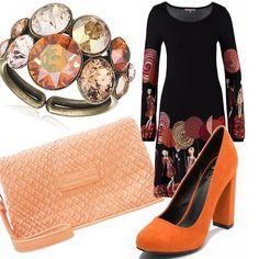 Questo outfit è molto particolare e adatto a chi ama il colore. Gli accessori sono tutti sui toni dell'arancione e il look resta comunque molto elegante. L'abito è nero con disegni sui toni del beige e del rosso. Lo vedo molto adatto per un apericena e per una serata romantica.