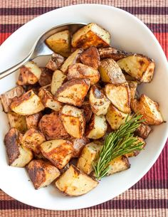 Roasted potatoes tossed with rosemary is a classic combination that I will never, ever get tired of eating. The real key is roasting the potatoes past mere tenderness and all the way until they've turned golden and crispy on the outside. I have a hard time getting these potatoes to the table without eating half the batch straight off the baking sheet. They're heavenly.