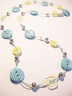 Could try the twisted embroidery thread as the cord. Like the bead, button combo. FAB KB!!! Stripey Button Necklace - The Supermums Craft Fair