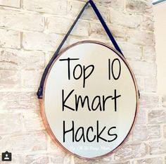 Top 10 easy kmart hacks using the kmart arrow light, plant stand, pineapple jar, shadow box, kmart house and hanging mirror for the Oh So Busy Mum