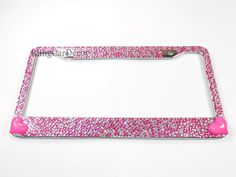 Stand out from the crowd with style and bling. These fancy encrusted rhinestone license plate frames are handmade with hundreds of the finest multi-size pink & clear rhinestones with two hearts embellishing a durable rust-free silver chrome metal frame. With fine precision, the crystals are securely adhered to the frame with an industrial strength adhesive, safe for car washes and all weather conditions. The frames are standard size for car, truck, van, SUV, & jeep license plates. Ea...