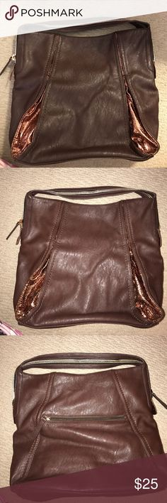 Brown Shoulder Bag This is a beautiful brown shoulder bag that has only been used twice. The inside is black with gold stars everywhere. It's my favorite part of the bag! There's an outside zipper on the bag. No signs of wear. Needs a good home! 💕 Bags Shoulder Bags