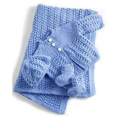 This lace layette set includes a blanket, booties, hat, and cardigan. (Lion Brand Yarn)