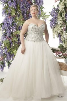 Corset bodice encrusted with pearls and crystals. Full ball gown tulle skirt Plus Size Wedding Dress.
