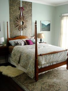 Wallpaper Magic  Give an ordinary headboard an extra flair with a little wallpaper, paint and glaze. Designer Kara Paslay used a roll of paintable wallpaper along with hanging wall decor to create this unique, inexpensive look.