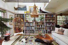 The homeowner's dog, Ali Baba, sprawls on a vintage rug in the book-lined living room.   Lonny.com