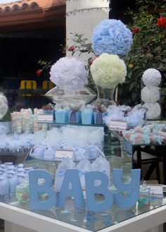 decor idea: blue painted B A B Y splelled out at table
