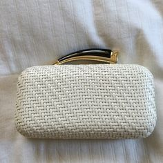 Vince Camuto Woven Horn Clutch White The clutch is beautiful and such an easy piece to pair with a dressy outfit. I love the optional chain if you want to go hands free. Used once but kept on the shelf because it is so pretty!! Vince Camuto Bags Mini Bags