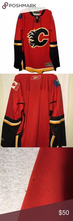 Reebok CCM Calgary Flames Hockey Jersey Mens XL Reebok CCM Calgary Flames hockey jersey in men's size XL.  No numbers or player names on front or back.  Has sewn Canada and Alberta flag patches on each shoulder.  Overall condition is very good plus. It does have a few thread picks typical of this type of material.  Needs to be washed before wearing as it smells of cologne.  See pics for more details.  MEASUREMENTS:  armpit to armpit:  25.5  inches  length:  35.5 inches Reebok Shirts