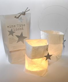 Paper Lanterns - I would put a plastic tea light in the bottom and cut stars out of the white bag so stars are projected on the wall #diy #star