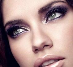 I don't know what I love more...Adriana Lima or her makeup!