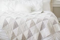 Gray and white half-square-triangles quilt