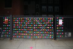yarn bombing with pompoms