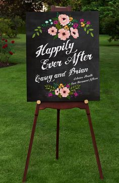 An elegant and stylish way to welcome your guests. Modern type, with colorful flowers on faux chalkboard background and faux chalk text. Personalized with your names and wedding date.