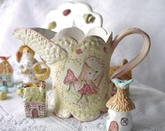 Ceramic Creamer Pitcher Hand Painted Brown Bird and Red Flowers and Mushrooms Each creation in my shop is unique and individually handmade.