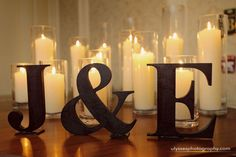 Giant initial letters and candles for a chic winter wedding | this will be great on one of our tables: gift/card, place card, guest book, etc.
